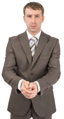 displeased businessman: Unhappy businessman holding hands in front of him and looking at camera Stock Photo
