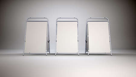 paper screens: Three small blank stands on grey wall background