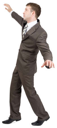 tiptoes: Businessman standing on tiptoes isolated on white background Stock Photo