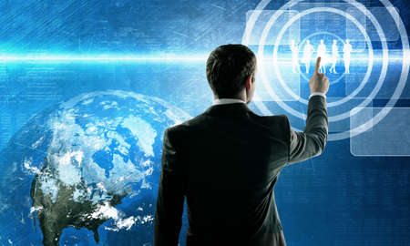 internet globe: Business man pushing virtual team. Teamwork concept. Element of this image furnished by NASA