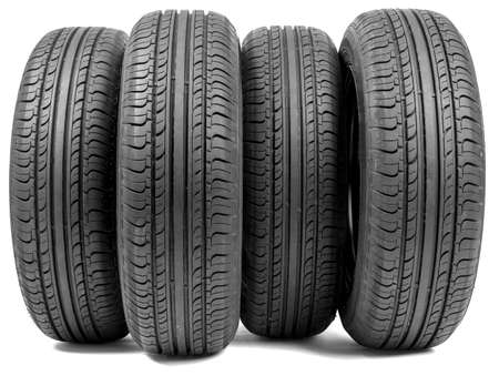 four wheel: Stack of four wheel new black tyres for summer car driving isolated on white background