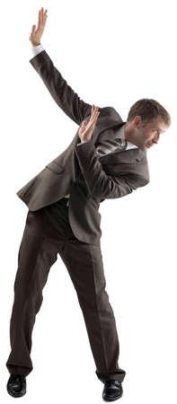 dodge: Isolated business man dodge something on white background Stock Photo