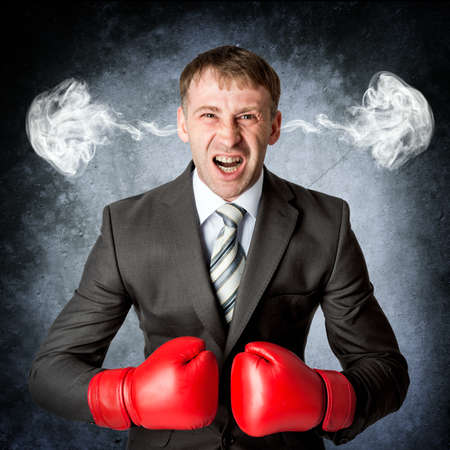 rage: Business man to rage and smoke in head. Emotion concept Stock Photo