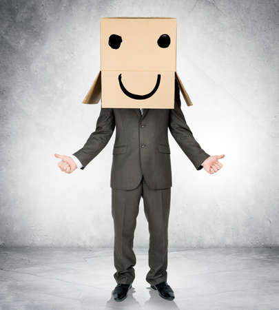reproach: Businessman gesturing with box on head and smiley face Stock Photo
