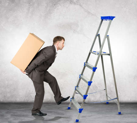 difficult task: Middle aged business man with difficult task going up ladder