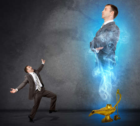 helpmate: Genie business man appearing from magic lamp. Help, assistance urgent solution concept Stock Photo