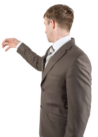 grabbing: Man in suit reaching for something from above with empty copy space, successful man with idea grabbing something Stock Photo