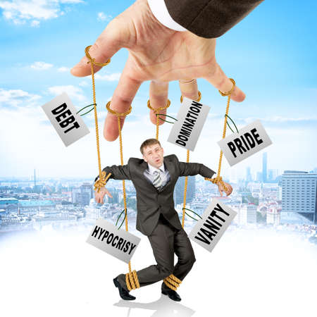 marionette: Image of businessman hanging on strings like marionette with words among clouds