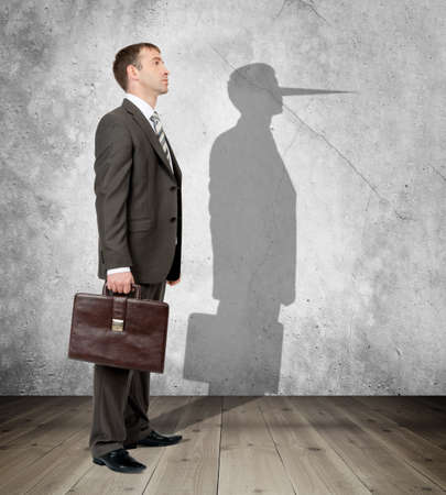 long nose: Businessman with long nose on his shadow