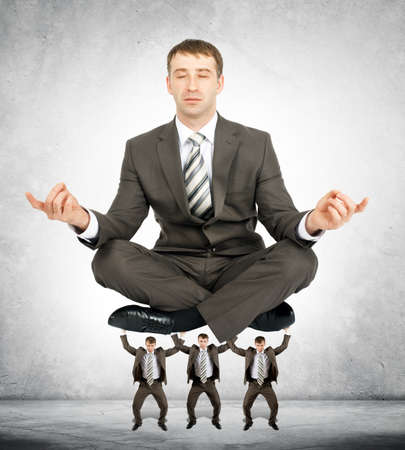 bureaucrat: Giant businessman sitting in lotus posture on little men