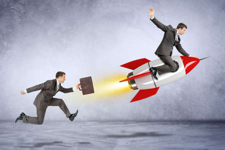 catch up: Businessman with briefcase trying to catch up flying businessman on rocket