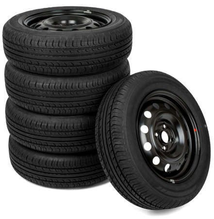 pneumatic tyres: Stack of wheels. Isolated on white background. Front view Stock Photo