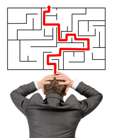 wayout: Confused businessman in front of labyrinth with red line showing the way out Stock Photo