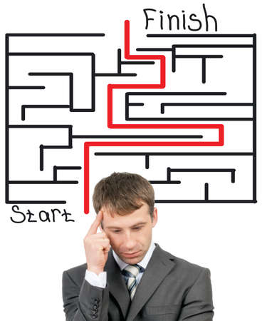 wayout: Thinking businessman in front of labyrinth with red line showing the way out