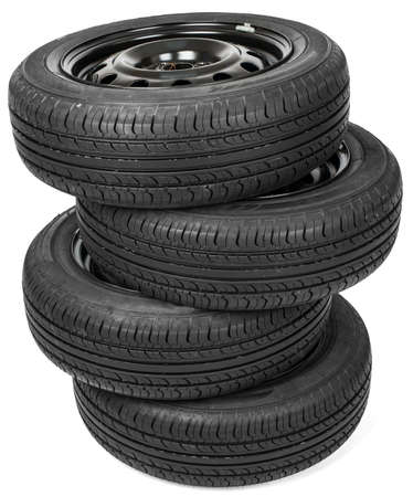 four wheel: Stack of four wheel black tyres for summer isolated on white background Stock Photo