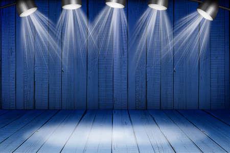 dramatics: Illuminated empty blue concert stage with soffits