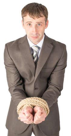 sad businessman: Sad businessman bound with rope isolated on white background