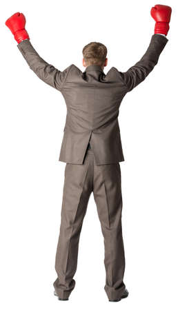 beat the competition: Portrait of a successful businessman. Isolated on white background, rear view