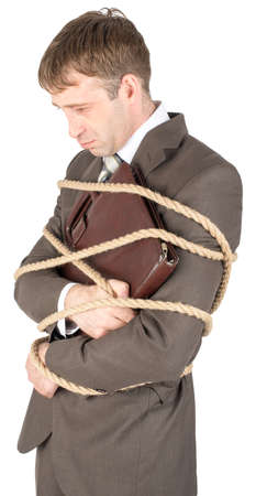powerless: Young sad businessman and briefcase tied with ropes