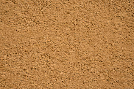 Decorative yellow plaster texture on wall 版權商用圖片 - 81616071