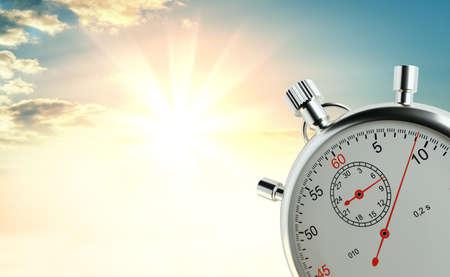 Analog stopwatch against the background of sunrise Stock Photo