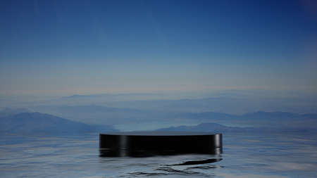 A black pedestal on the sea surface. Mountains in the fog in the background Reklamní fotografie
