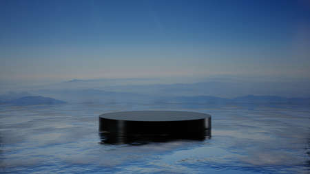 A black pedestal on the sea surface. Mountains in the fog in the background 스톡 콘텐츠