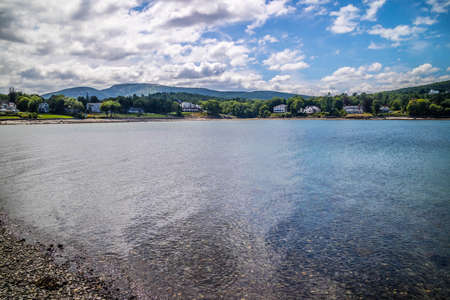 A portrait shot of the Frenchman Bay in along the shore of Bar Harbor Stock Photo
