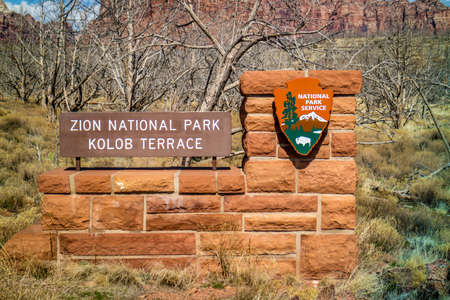 Zion National Park, UT, USA - March 18, 2018: The A welcoming signboard at the entry point of the preserve park