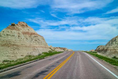 A long way down the road of Badlands National Park, South Dakota