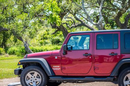 Aransas NWR, TX, USA - April 21, 2019: A Jeep Wrangler Unlimited Sports parked along the preserve park Redakční