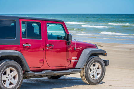 Padre Island NS, TX, USA - April 20, 2019: A Jeep Wrangler Unlimited Sports parked along the preserve island