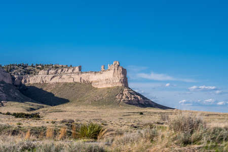 A natural rock formation of rugged badlands and towering bluffs Stock Photo