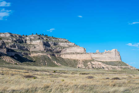A natural rock formation of rugged badlands and towering bluffs Standard-Bild