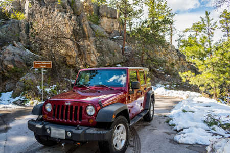 Black Hills National Forest, SD, USA - May 24, 2019: A Jeep Wrangler Unlimited Sports parked along CC Gideon Tunnel