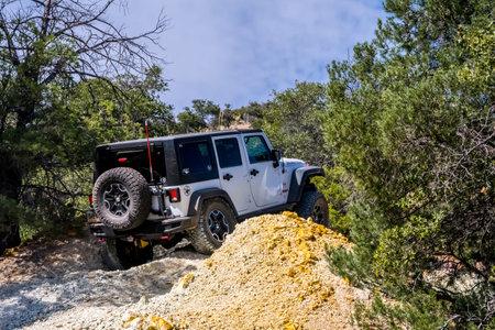 Benson, AZ, USA - Sept 5, 2019: A Jeep Wrangler Rubicon taking an off-road course