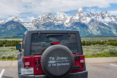 Grand Teton NP, WY, USA - June 22, 2019: A Jeep Wrangler Unlimited Sports parked along the preserve park