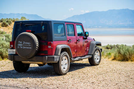 Antelope Island SP, UT, USA - August 2, 2019: A Jeep Wrangler Unlimited Sports parked along the preserve park