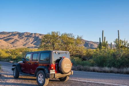 Saguaro NP, AZ, USA - November 16, 2019: A Jeep Wrangler Unlimited Sports parked along the preserve park