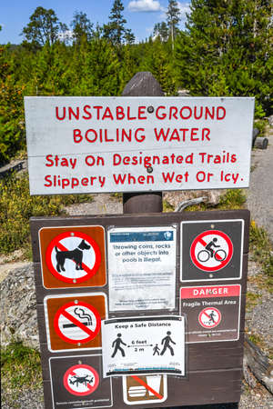 Yellowstone NP, WY, USA - August 7, 2020: A notice for unstable ground boiling water