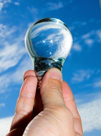 a bulb with water lies in masculine hands Standard-Bild