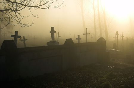 Old gloomy cemetery in a morning fog Stock Photo