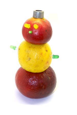 repast: The figure of a snowman is constructed from apples Stock Photo