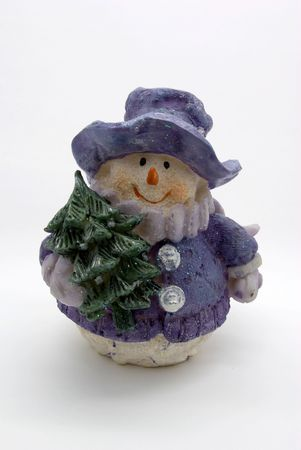 hilarity: Toy a snowman with a fir tree on a white background