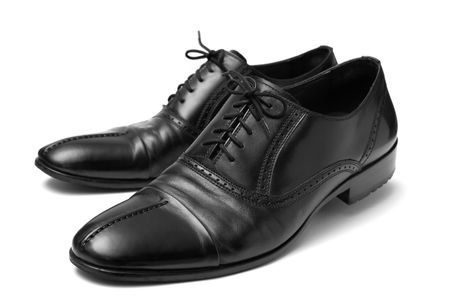 shoestring: classic black shoes for men on a white background