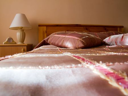 sleeping room: sofa, pillows, lamp on a bedside table Stock Photo - 3561122