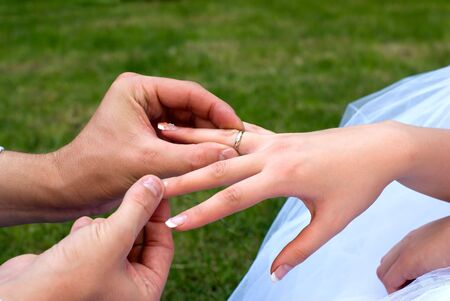 fiancee: fiance puts a ring on a finger to fiancee