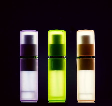 Three bottles with perfume in polarized light