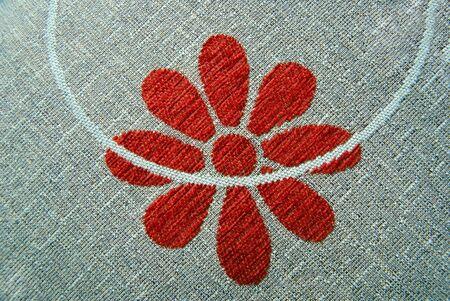 modelo rojo de la flor en la materia textil Foto de archivo