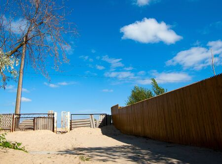 landscape with blue sky, sund and fence